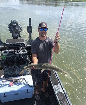 bowfishing for gar with bow and arrow