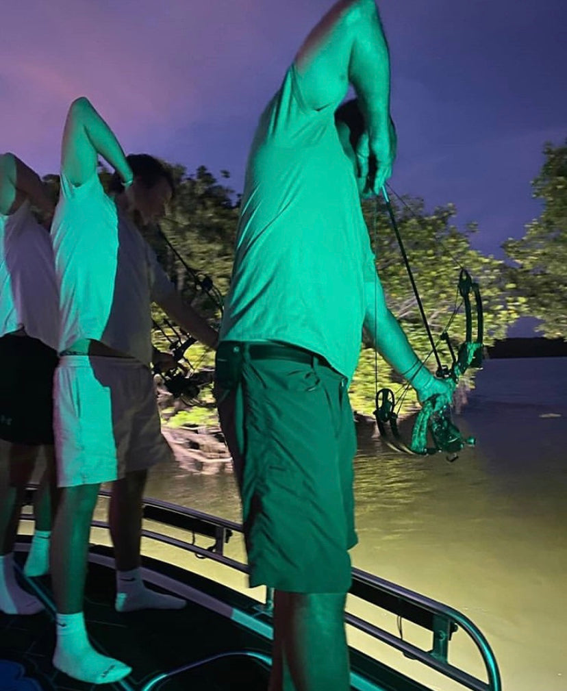 bowfishing at night with bright lights for invasive species