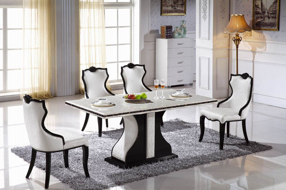 white marble tables and 4 chairs