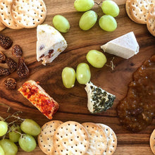 The Vegan Dairy - Aged and Smokey, Fruit Cheese, Dill Chevre On A Cheese Platter with crackers, grapes, figs and chutney