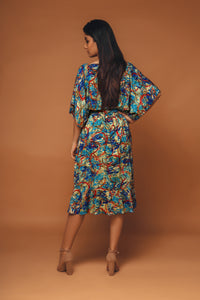 Farfalla - Abstract printed overlap dress with self tie belt