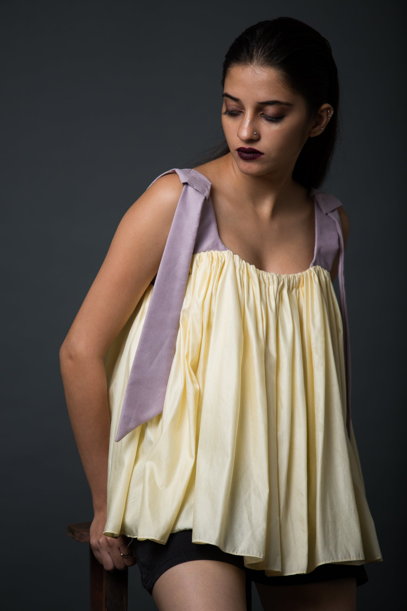 Liberta - Frilled top with faux suede straps