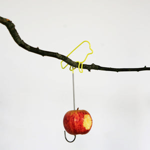 Yellow Wire Bird Feeder with apple on branch