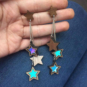 Triple Star Stud Earrings on a hand