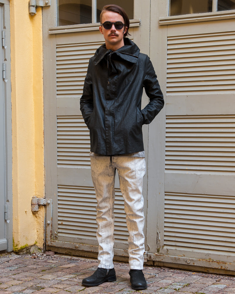 Army of me coated linen jacket with white painted jeans by Leon Louis