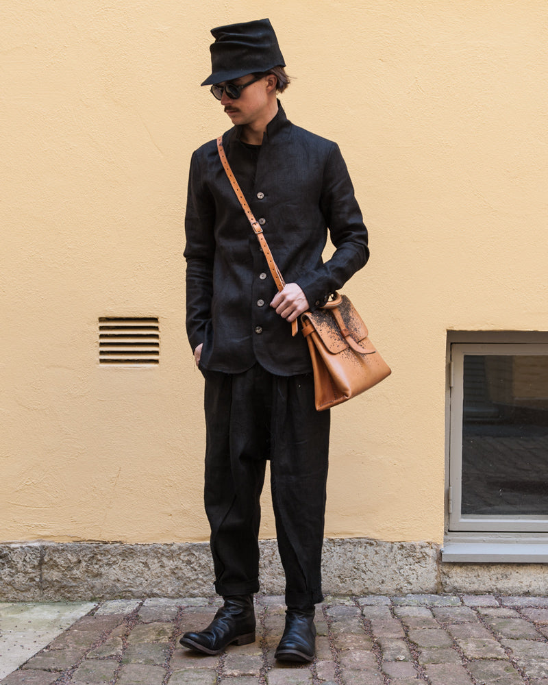Atelier aura linen suit with a horisaki hat