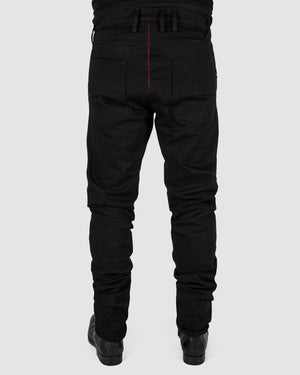 Zam Barrett - Red stitched pants - https://stilett.com/