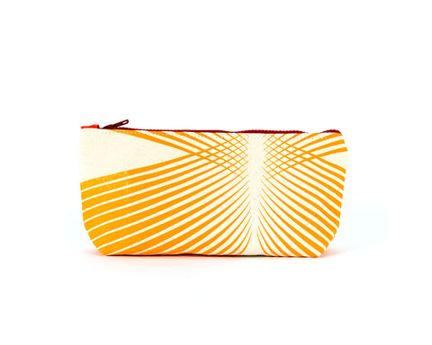 Knitting notions and pencil case with an orange stripe pattern.