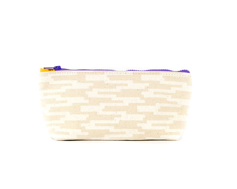 Knitting notions and pencil case with white geometric pattern.
