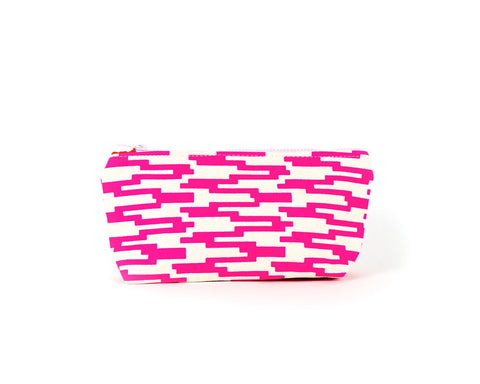 Knitting notions and pencil case with hot pink geometric pattern.