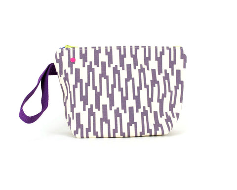 small knitting project bag with grommet system and mauve geometric pattern.