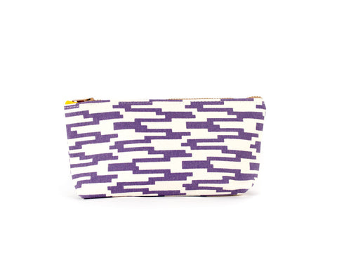 Knitting notions and pencil case with mauve geometric pattern.