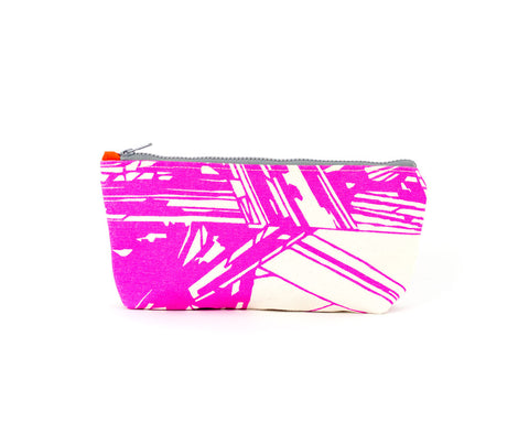 Knitting notions and pencil case with hot pink abstract, geometric pattern.