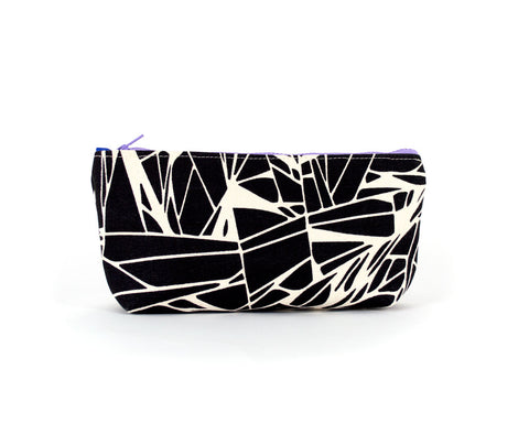 Knitting notions and pencil case with abstract black geometric pattern.
