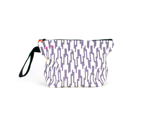 Picture showing a medium project knit bag with grommet and snap system. Mauve geometric pattern.