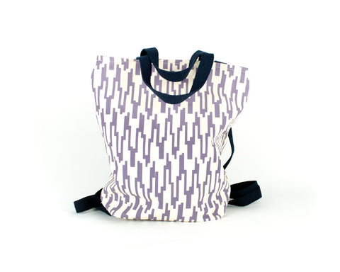 Backpack with adjustable straps and handles and zipper closure. Mauve geometric pattern print.