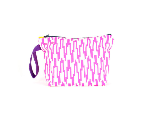 Picture showing a medium project knit bag with grommet and snap system. Hot pink geometric pattern.