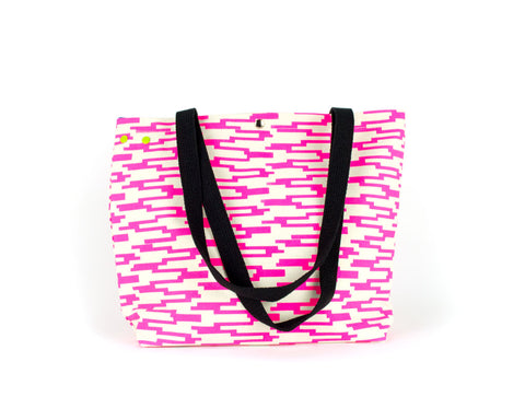 Large project knitting bag with unique grommet snap system with a hot pink geometric pattern.