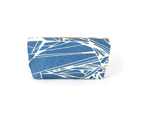 Knitting notions and pencil case with metallic blue abstract pattern.