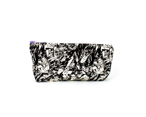 Knitting notions and pencil case with black abstract pattern.