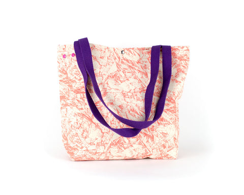Large project knitting bag with unique grommet snap system with a coral colored abstract pattern.