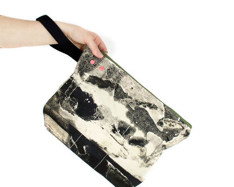 Person holding a medium project bag with grommet and snap system. Black and white design.