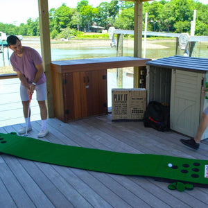 An image showing a man playing the PutterBall golf putting game on a dock.