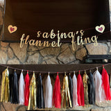 personalized flannel fling banner with flannel hearts and flannel tassel garland
