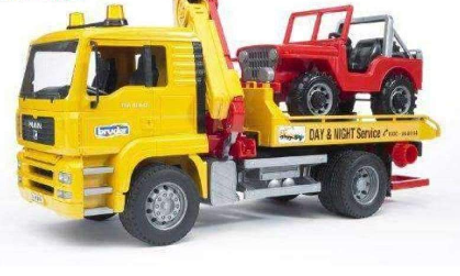 Image of Bruder Man Replica Tow Truck With Country Vehicle