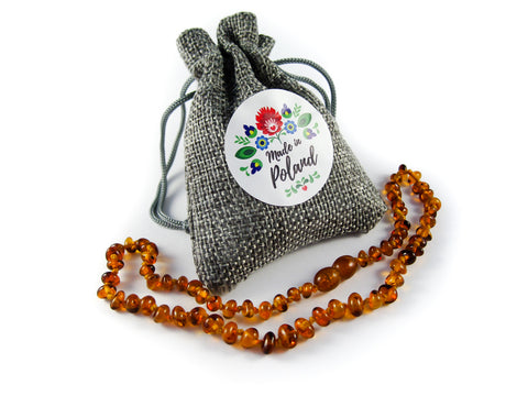 amber teething necklace in a jute bag, made in poland, polish baltic amber, cognac beads