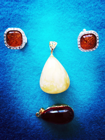 Face made of Amber cufflinks and amber pendants