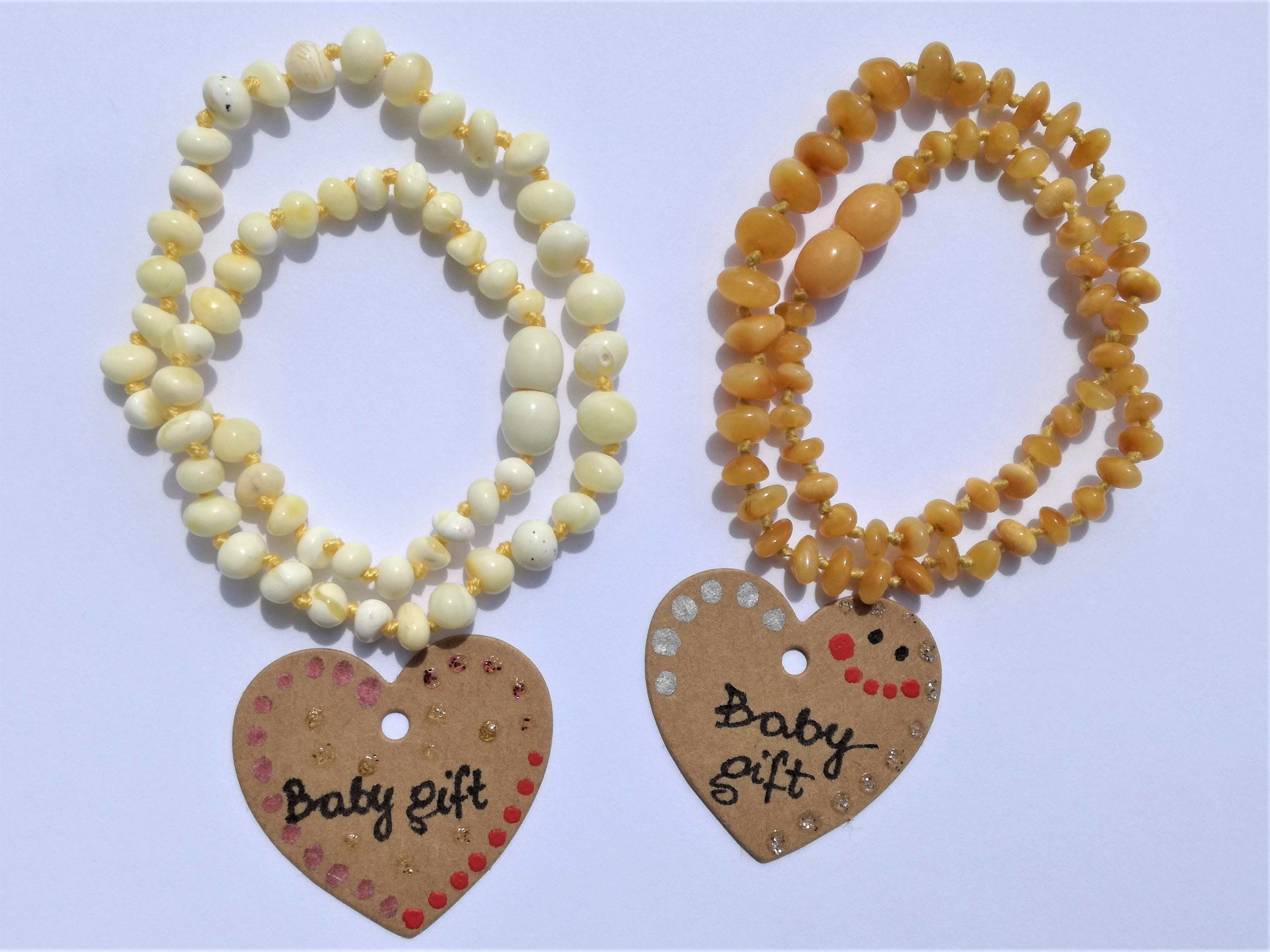 amber teething necklace, limited edition, premium products, white and antiqued polished beads, plastic screw clasp, healing, succinic acid, genuine baltic amber, safe for babies and nursing mums, made in poland,  personalized labels available