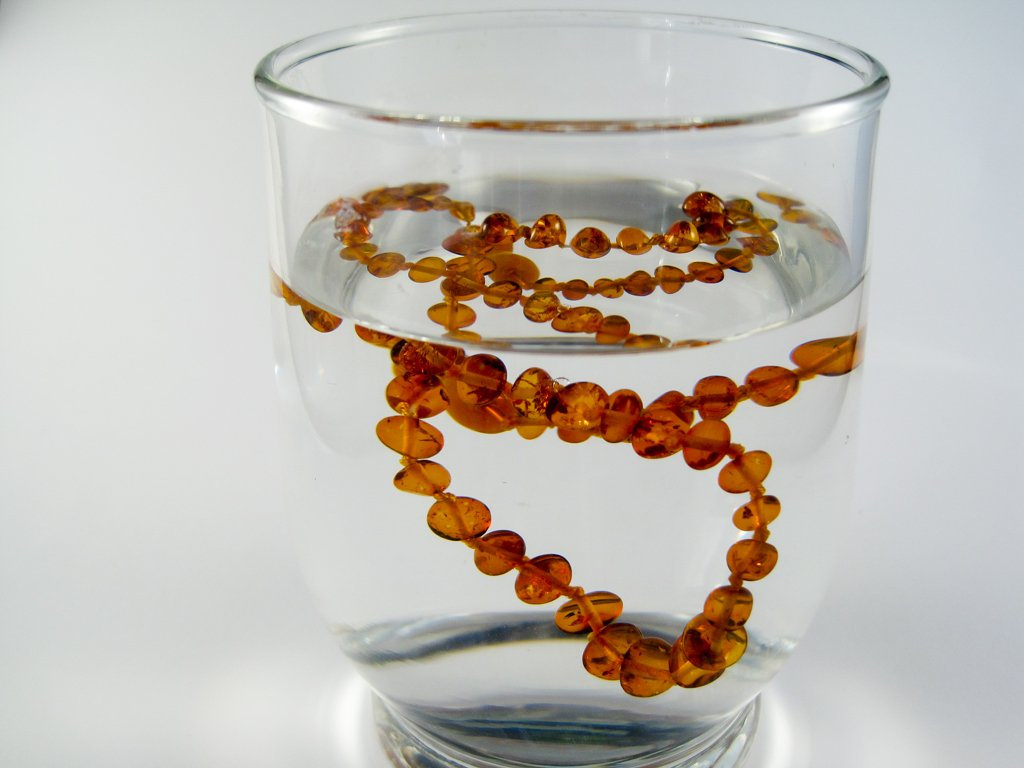 amber teething necklace in salted water, test for original, genuine baltic amber