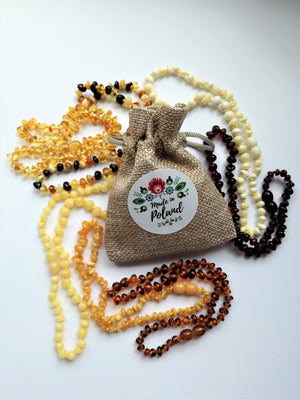 amber teething necklace, from Poland, personalized gift for baby, white, lemon, egg-yolk, yellow, cognac, cherry, multicolor and antiqued polished amber beads, heart personalized labels, plastic screw clasp, healing, succinic acid, genuine baltic amber, for babies and nursing mums, made in poland, in a jute bag