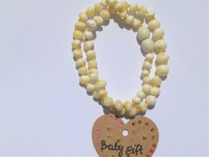 amber teething necklace, white polished beads, premium product, limited edition, plastic screw clasp, healing, succinic acid, genuine baltic amber, safe for babies and nursing mums, made in poland