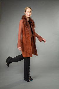 Long SUEDE VEST w/ removable RACCOON collar. Front pockets.  Back slit. Rust