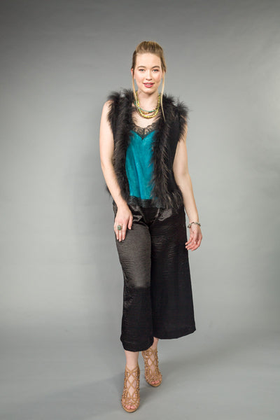 Fitted knit VEST trimmed w/ RACCOON.  Hook & eye closure Black