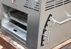 Adjustable grill grate height