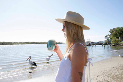 Reusable ceramic coffee cup at Noosa River