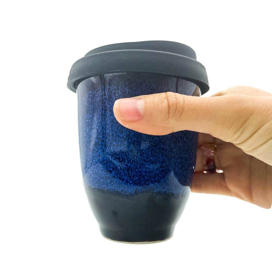Dark blue ceramic cup