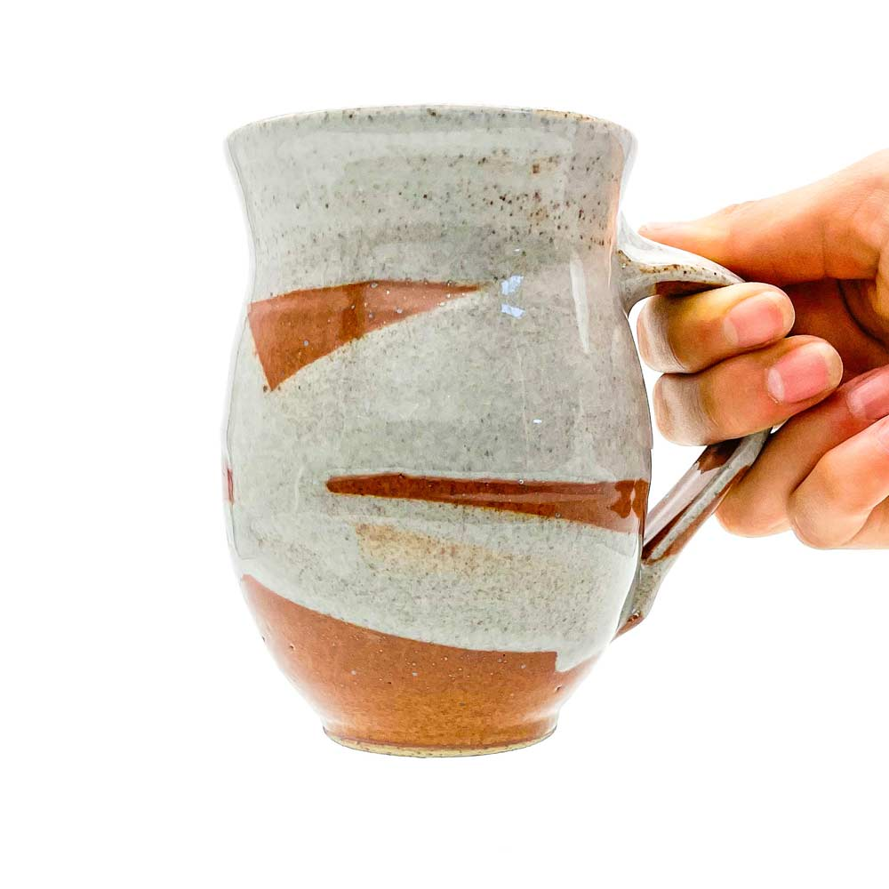 Pottery For The Planet Stoneware Mug in hand