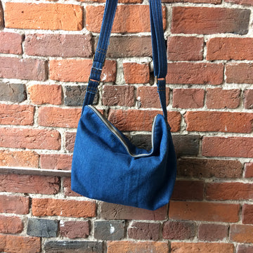 Denim crossbody bag handmade by Doyle & Day. Solid Cast Brass hardware and YKK zippers