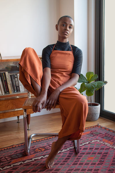 black mock neck top with rust jumpsuit