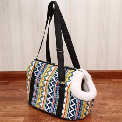 Travel shoulder bag style dog carrier with fur lined padded inner for a puppy or small dog multicoloured Aztec design