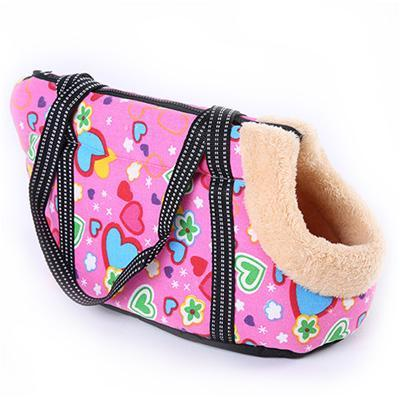 Travel shoulder bag style dog carrier with padded fur lined inner for a puppy or small dog pink hearts design