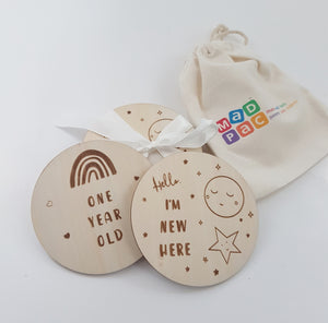 14 Wooden Baby milestone discs (2 designs - Rainbow and Moon) with a little cotton bag. 7 reversible discs