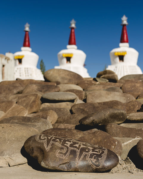 A mani stone carved with a mantra. Typically 'Om Mane Padme Hum' is the most common hymn found carved on the mane stones.