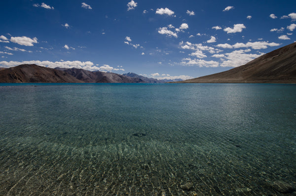 Pangong Tso, situated at a height of about  4,350 metres, is one of the coldest places I've been to. Admittedly my threshold for cold is nothing much to write about, but Pangong Tso is brrrrr-cold. So cold that it freezes completely in winters, despite being a saline water.