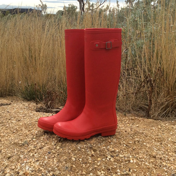 Red Tall Wellies In The Garden