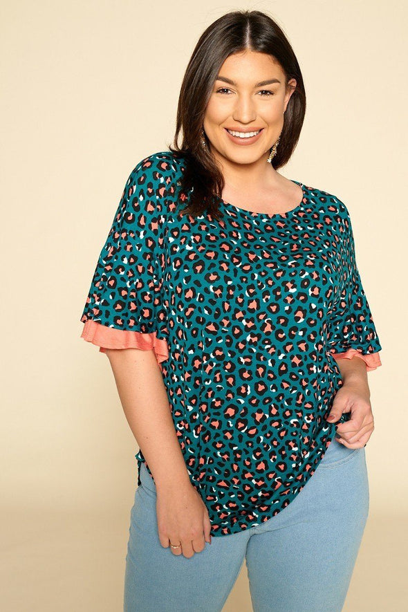 Plus Size Animal Print Swing Tunic Top With Contrast Color Block Bell Sleeves - Babe Shoppe